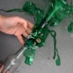 Florero. Hojas verdes de plantas para flores con botellas de plástico pet recicladas - Green leaves from reccled plastic bottles ( pet )