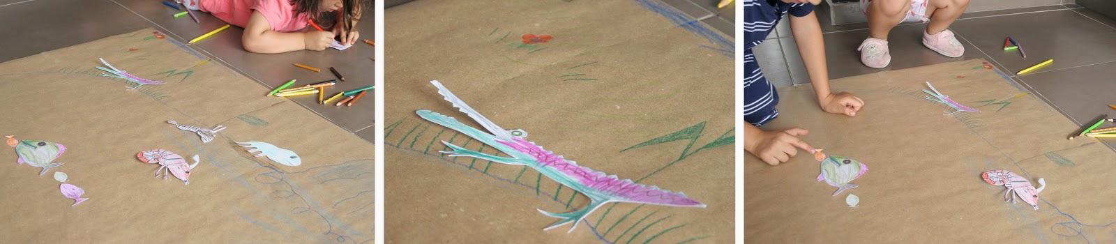 Peces en el lago del juego de pesca con clips