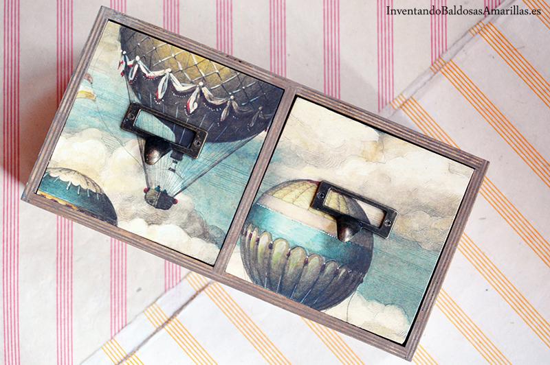 cajones decorados con papel y tiradores
