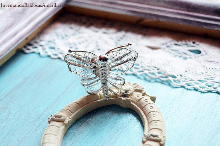 tirador en forma de mariposa