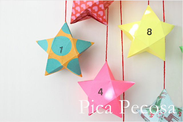 calendario-adviento-diy-trozo-madera-pinzas-ropa-adornadas-washi-tape-cajas-papel-forma-estrella