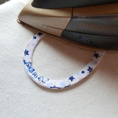 cinta para colgar el abrigo bordada