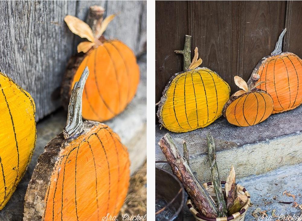 calabazas de halloween con troncos de madera