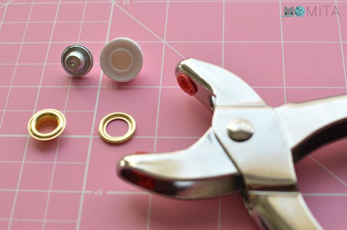 como poner ojales metalcios
