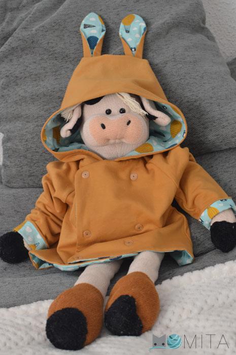 Coser abrigo para niño