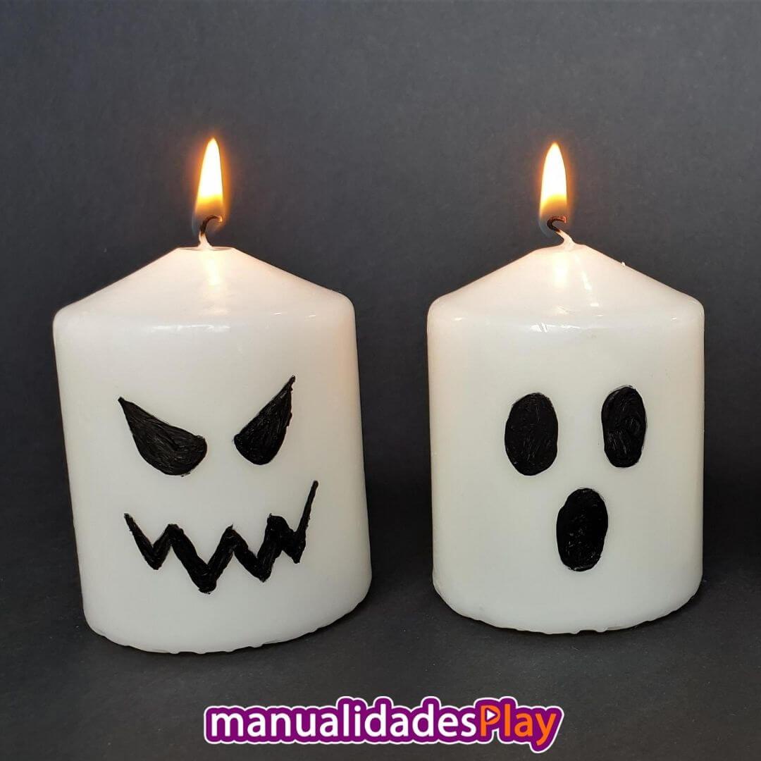 Velas decoradas con caras de fantasma para Halloween