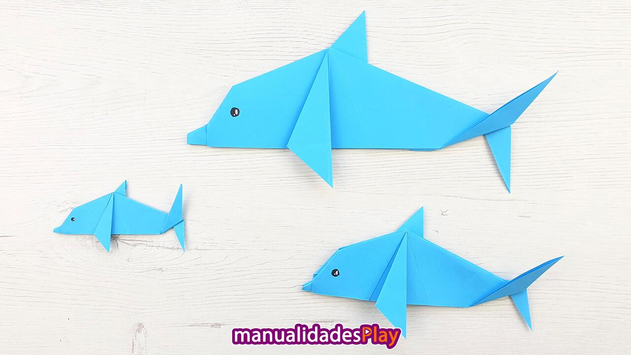 Familia de delfines de papiroflexia que incluye el padre, la madre y el delfín bebe