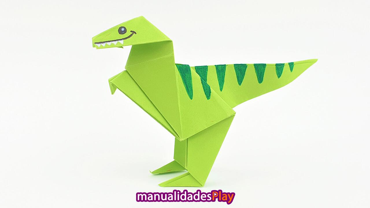 Dinosaurio de origami realizado con una hoja de papel