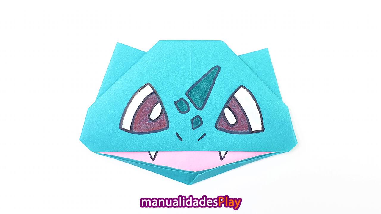 Cara de pokemon bulbasur de origam realizada con hoja de papel azul